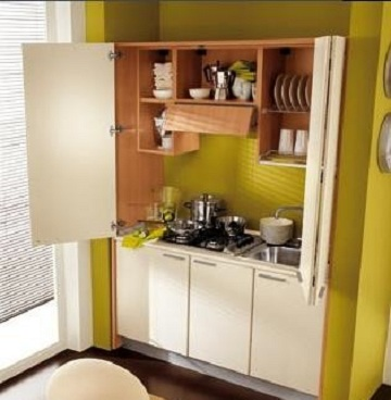 Soluciones ocultas para espacios reducidos for Cocinas modernas para apartamentos pequenos
